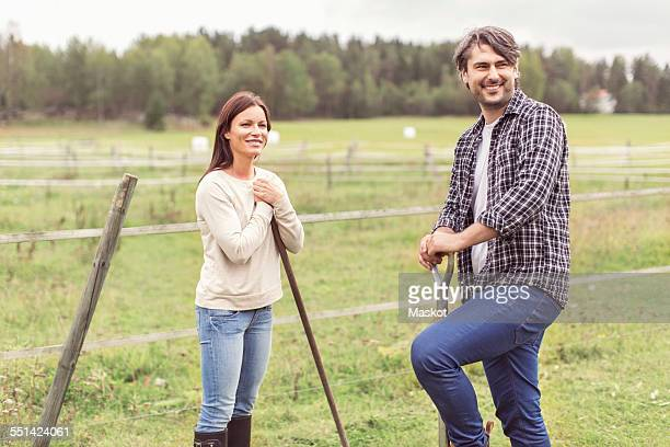 Happy mid adult couple working in organic farm