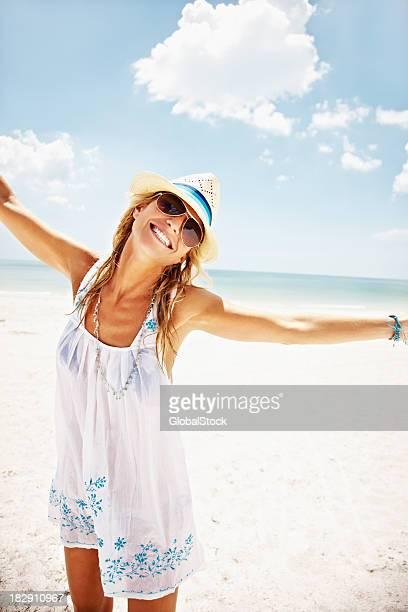 Happy mid adult woman enjoying on beach