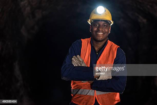 Happy miner working at the mine