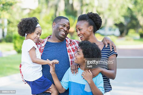 Happy mixed race African American family of four