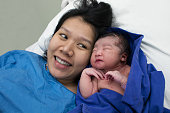 mother and childbirth baby asian girl on hospital Beds at maternity ward