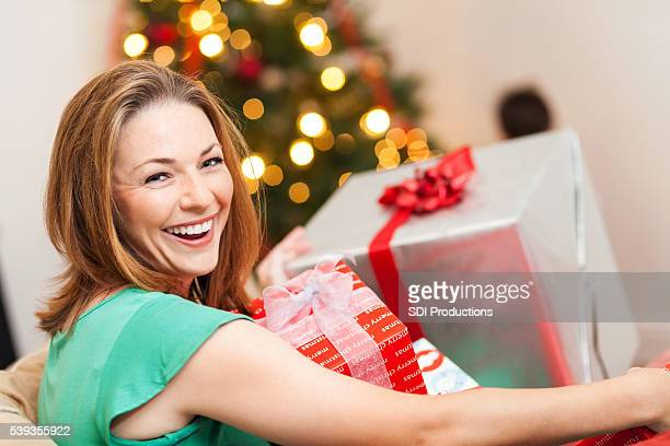 Happy mom with Christmas presents