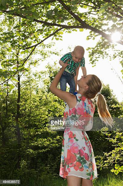 Happy mother and baby in nature