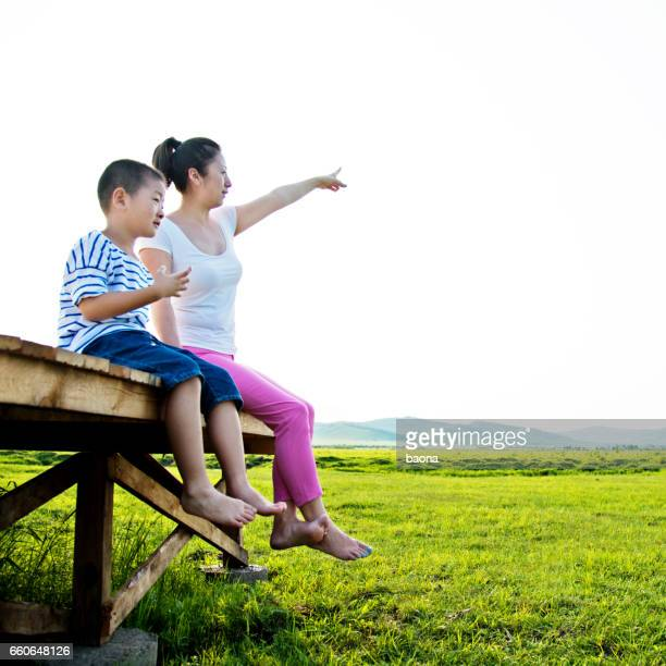 Happy mother and child boy sitting together