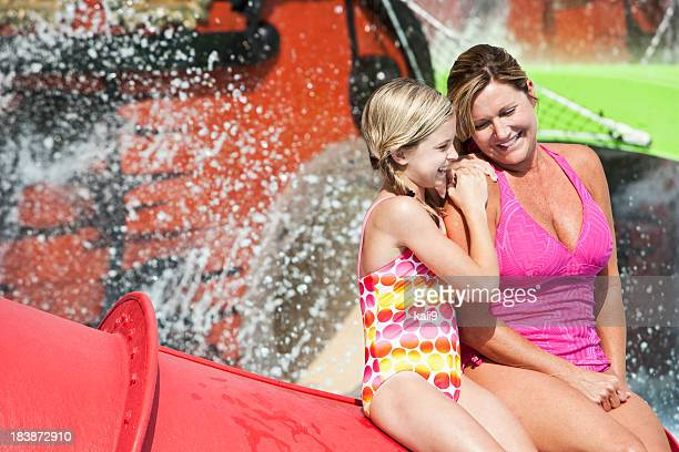Happy mother and daughter at water park