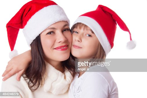 Happy mother and daughter hugging in Christmas hat : Stock Photo