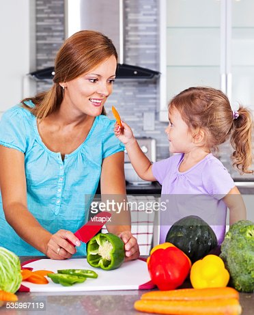 Happy mother and daughter in the kitchen : Stock Photo