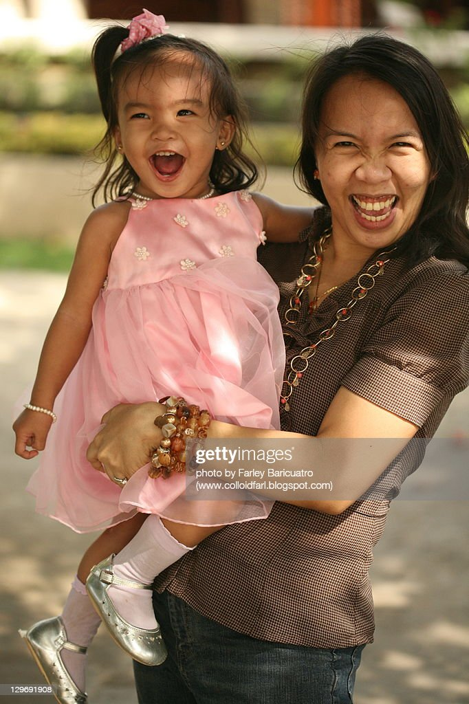 Happy mother and daughter : Stock Photo