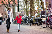 "happy mother and daughter stroll around the old city delft, netherlands""n"