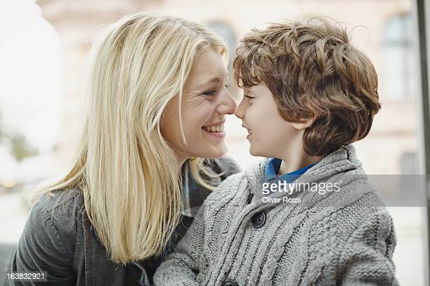 Happy mother and son face to face