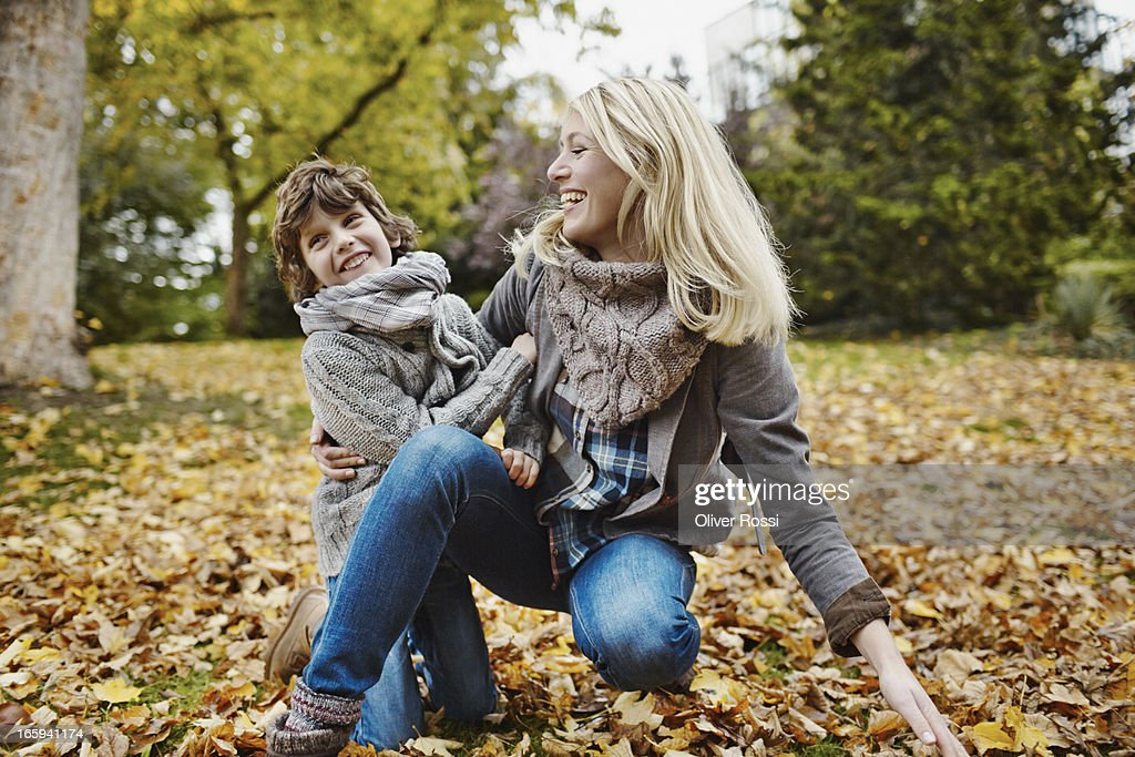 Happy mother and son in park : Stock Photo
