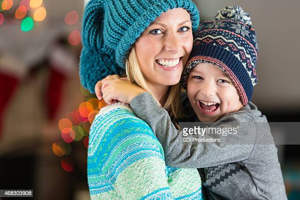 Happy mother and son wearing winter clothing on Christmas day