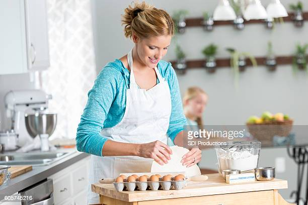 Happy mother baking a pie for her family