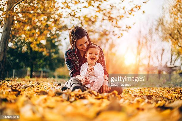 Happy mother with child in park