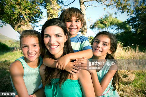 Happy mother with her family outdoors