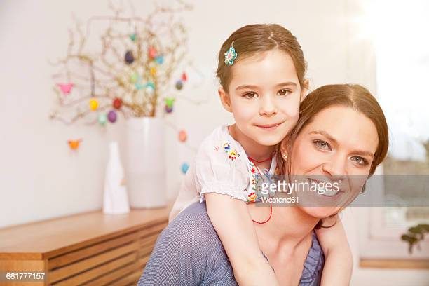 Happy mother with her little daughter at home