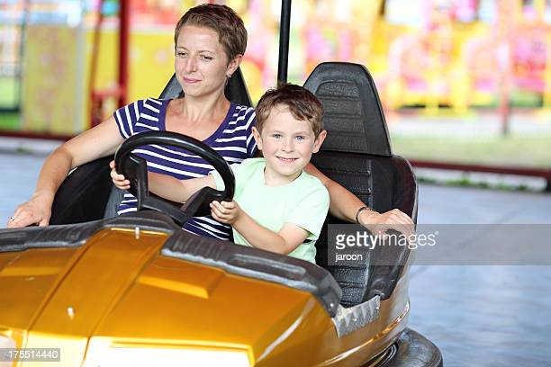 happy mother with son in the amusement park