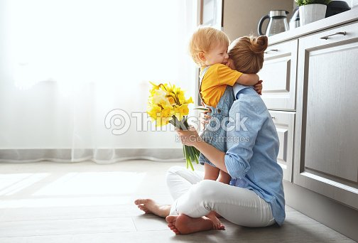 happy mother's day! baby son gives flowersfor  mother on holiday : Stock Photo