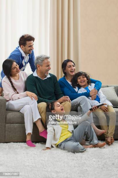 Happy multi generation family watching television