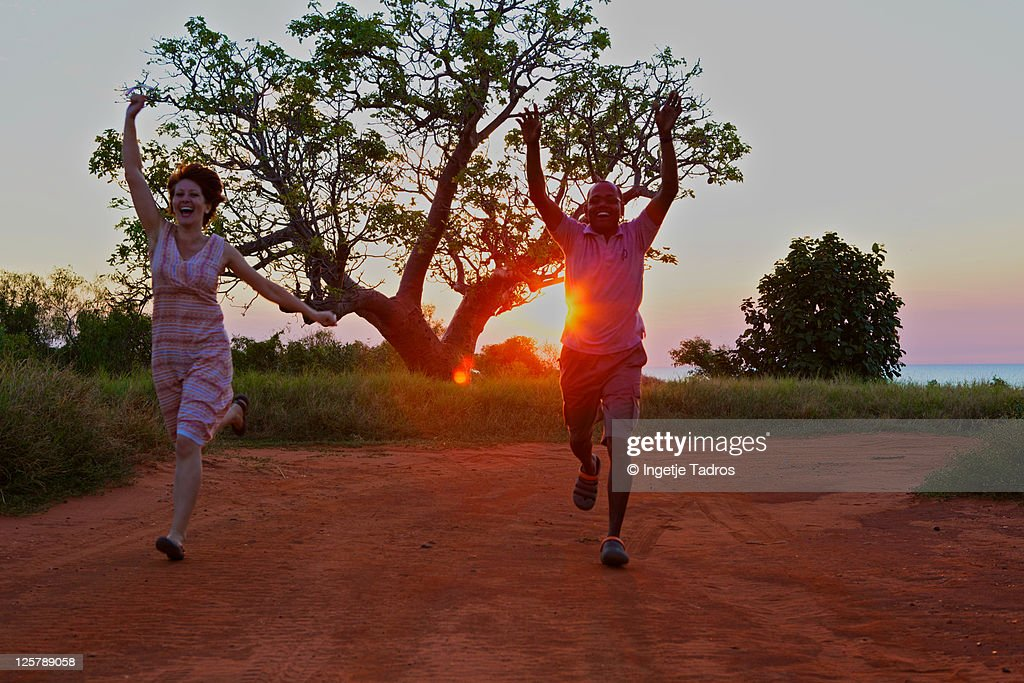 Happy Multicultural couple running. : Stock Photo