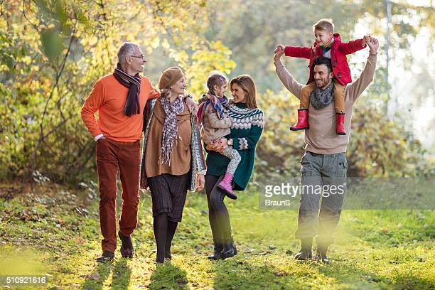 Happy multi-generation family spending an autumn day in the park.