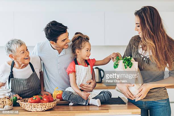 Happy multi-generation family with groceries