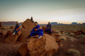 Happy young family of Navajo people posing and laughing together on their land in Monument Valley Arizona