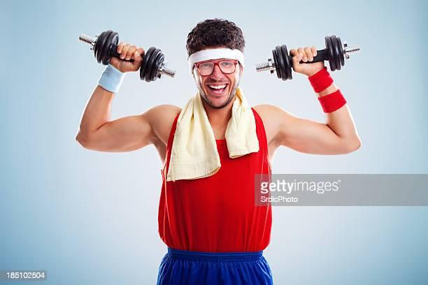 Happy nerd bodybuilder lifting weights