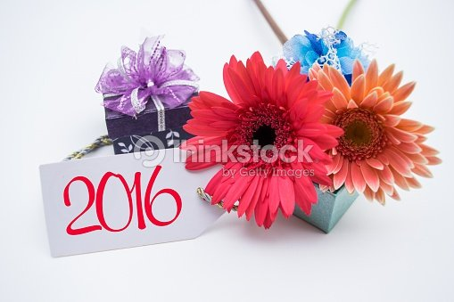 happy new year 2016 with flower and tag stock photo
