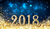 Golden Numbers 2018 On Glitter And Night Blue Background