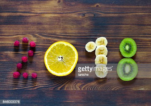 happy new year 2018 of fruit and berries on wooden background. : Stock Photo