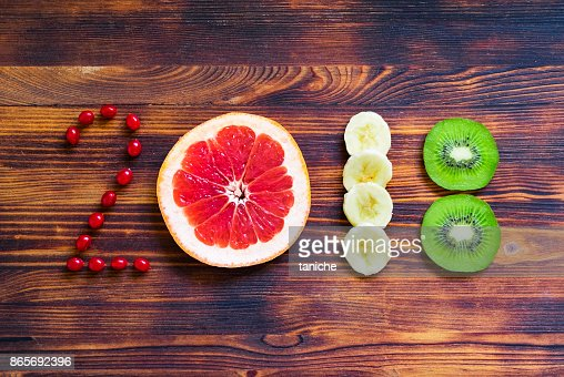 happy new year 2018 of fruit and berries on wooden background. : Foto de stock