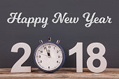 Happy New Year 2018 with Blue Clock on Desk