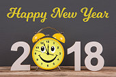 Happy new year concepts 2018 countdown clock on desk