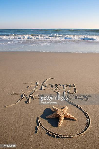 Heureuse nouvelle année Message rédigées Étoile de mer sur une plage de sable