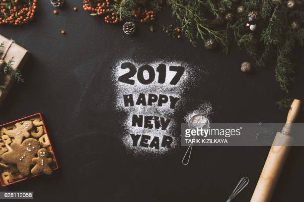 Happy new year text written with powder sugar 2017