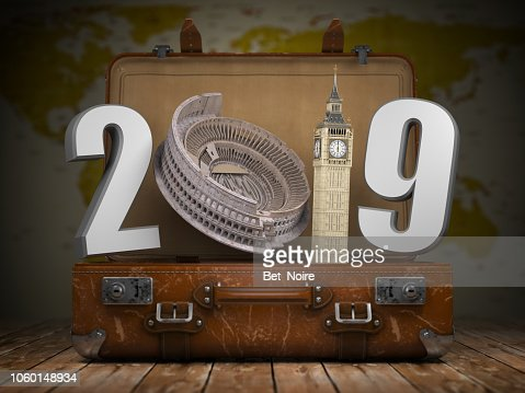 2019 Happy new year. Vintage suitcase with number 2019 as Coloisseum and Big Ben tower. Travel and tourism concept. : Stock Photo