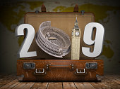2019 Happy new year. Vintage suitcase with number 2019 as Coloisseum and Big Ben tower. Travel and tourism concept. 3d illustration It was generated using map data from the public domain http://www.li