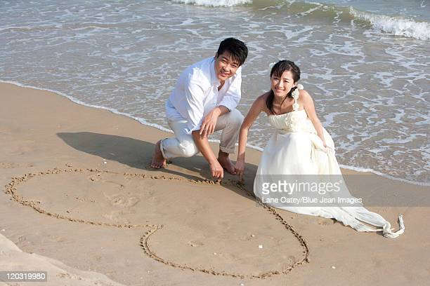 Happy Newlyweds on the Beach