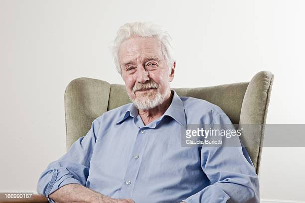Happy Old Man Sitting on a Chair