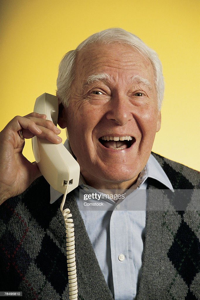 Happy older man on phone : Stock Photo