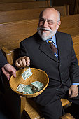 Senior adult happy to make a donation to the church  - See lightbox for more