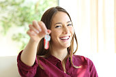 Happy apartment owner or renter showing keys and looking at you