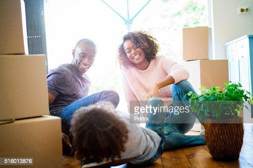 Happy parents looking at son in new house