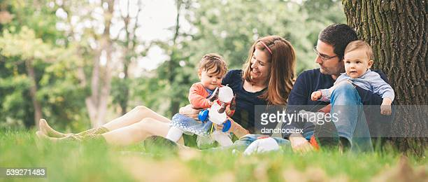 Happy parents with kids enjoying spring time in nature