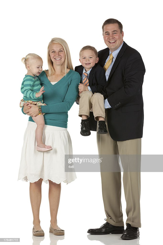 Happy parents with their children : Stock Photo