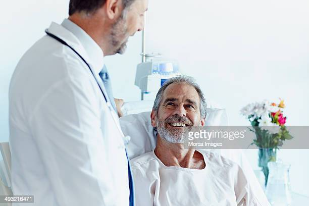Happy patient with doctor in hospital