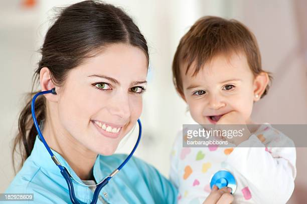Happy Pediatrician with baby