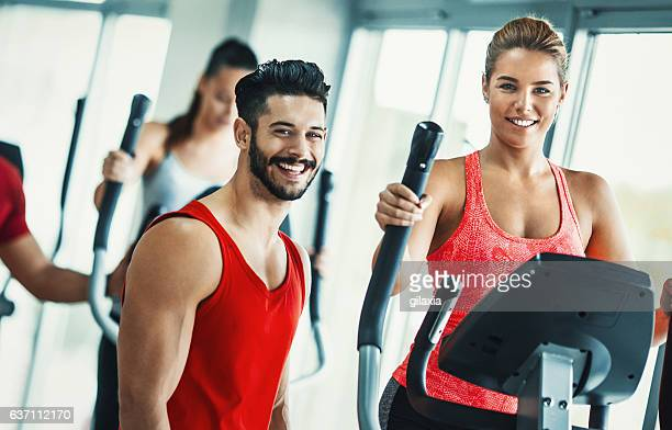 Happy people at a gym.
