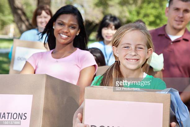Happy people holding boxes of donations